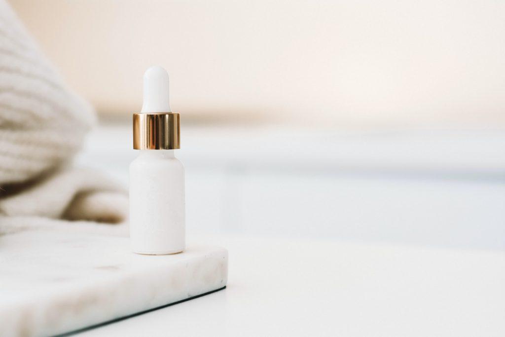 white drop bottle on white surface